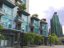 Modern high rises at Vancouver downtown. Modern luxury apartment buildings in downtown Vancouver blending urban living with a park like setting Stock Photos