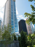 Modern high rises at Vancouver downtown. Modern luxury apartment buildings in downtown Vancouver blending urban living with a park like setting Stock Photography