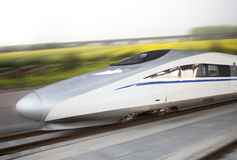Modern high speed bullet train on track Stock Photos