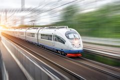 Modern high speed electric passenger driving past the station in the city stock photos