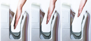 Modern high speed hand dryer. Three images showing hands slowly withdrawing from modern hand dryer Royalty Free Stock Photography