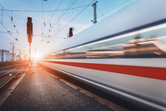 Modern high speed passenger train on railroad in motion Royalty Free Stock Photos