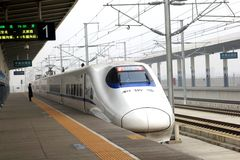 Modern magnetic levitation high-speed rail (HSR) bullet train at the railway station of Pingyao, Xian, China Royalty Free Stock Photography