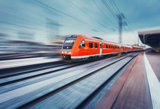 Modern high speed red passenger commuter train. Railway station Stock Image