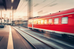 Modern high speed red passenger commuter train. Railway station Stock Images