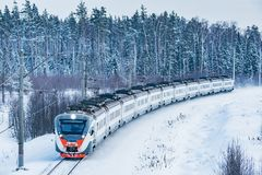Modern high-speed train approaches to the station. At winter morning time royalty free stock photo