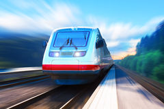 Modern high speed train. Creative abstract railroad travel and railway tourism transportation industrial concept: scenic summer view of moving modern high speed Stock Images