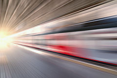 Modern high-speed train moves fast. Modern high-speed train moves fast along the platform Royalty Free Stock Photos