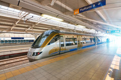 Modern high-speed train. Side and nose end view of a modern high speed commuter train in the station royalty free stock photo