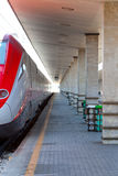 Modern high speed train at train station Royalty Free Stock Photos