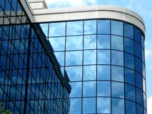Modern high tech building. Clouds reflected in windows of a modern building Royalty Free Stock Photo
