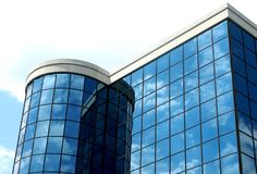Modern high tech building. Clouds reflected in windows of a modern building Royalty Free Stock Image