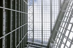 Big white office building blue sky palm construction many high tech Den Haag Hague inside within indoors modern neoteric new. Modern high-tech design of white Royalty Free Stock Image