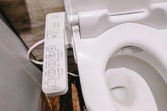 Modern high-tech toilet met elektronisch bidet in Thailand de kom van het de stijltoilet van Japan, geavanceerd technisch royalty-vrije stock foto's