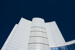 Modern high white business building. On a background of blue sky without clouds, contrast image Stock Photography