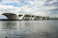Modern Highway Bridge across a River. Modern Highway Bridge across the Potomac River in Alexandria, VA, under Cloudy Sky on a Fall Day Royalty Free Stock Photo