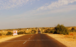 Modern highways and roads network connectivity in India. Modern transportation Highway connectivity roads in remote Rajasthan desert India to promote tourism Royalty Free Stock Photo