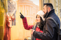 Modern hipster couple shopping on winter cloth pointing moda sto Stock Image