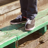 Modern hipster in gumshoes in summer Royalty Free Stock Images