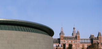 Modern and historic Amsterdam. New van Gogh Museum pavilion with Rijksmuseum in the background. Amsterdam, Netherlands royalty free stock photo