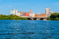 Modern and historic buildings along the embankment and Makarov bridge, Yekaterinburg, Russia Stock Photography