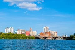 Modern and historic buildings along the embankment and Makarov bridge, Yekaterinburg, Russia - panoramic view Royalty Free Stock Photo