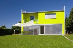 Modern home. Modern green house with garden Stock Image