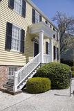 Modern home. Front view of a modern home with wooden stair case leading to front door Royalty Free Stock Photography