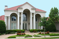 Modern Home. Large beautiful modern home with tall columns at the entrance royalty free stock image