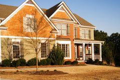Modern Home. A bright spring morning shot of this new modern home.  It has shingle, wood and brick siding Stock Photos