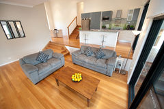 Modern home decor. Wooden polished floor compliments this home with 3 levels and interior stairs throughout Stock Photography