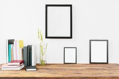 Modern home decor with blank painting frames mock up design Royalty Free Stock Photo