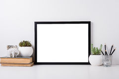 Modern home decor mock-up. Modern home decor with frame and interior objects, design ready poster mock-up Stock Image
