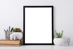 Modern home decor mock-up. Modern home decor with frame and interior objects, design ready poster mock-up Royalty Free Stock Images