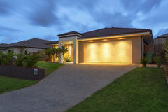 Modern home at dusk stock photography