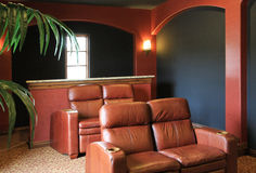 Modern home entertainment room. Cushy chairs adorn this modern home's video entertainment room Stock Image
