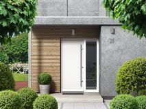 Modern home entrance with front door and front yard stock photos