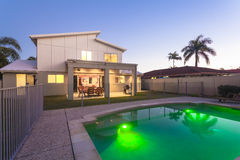 Modern home exterior at dusk royalty free stock photography