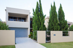 Modern home exterior. Modern multi level home exterior with pine trees Stock Image
