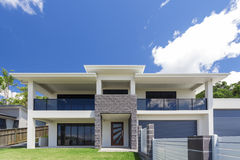 Modern home exterior. On a sunny day royalty free stock photography