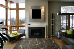 Modern home fireplace. With large windows Stock Photography