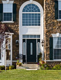 Modern Home Front. Front of a modern stone home with an elegant entranceway Royalty Free Stock Photos