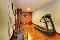 Modern home gym in the basement. Stock Photo