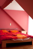 Modern home interior. Bedroom in a penthouse Stock Image