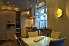 Modern Home Interior. Interior view of a modern kitchen and dining area Stock Image