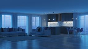 Modern home interior with gray kitchen. Night. Evening lighting. stock images