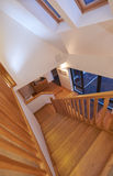 Modern Home Interior. Looking down the stairs towards the doorway of a modern home interior Royalty Free Stock Photo