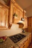 Modern Home Kitchen Cabinets Range Hood. Modern home with lovely custom kitchen cabinets and range hood Stock Images
