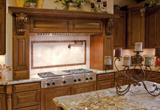 Modern home kitchen stainless gas range Stock Photography