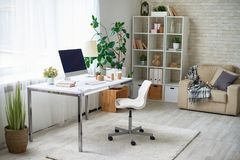 Modern Home Office. Background image of empty office space in cozy apartment with modern Scandinavian design Royalty Free Stock Photo